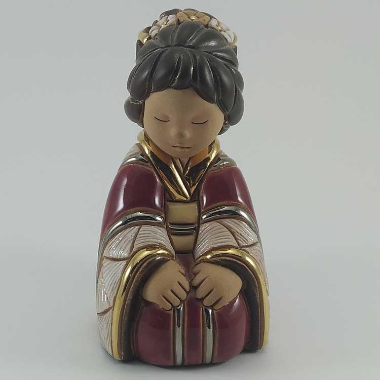 copy of Figura de cerámica artesanal: Niña con bolso