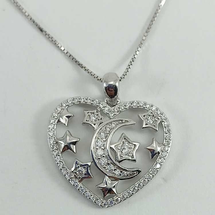 Colgante corazón con luna y estrellas en plata 925 mls.